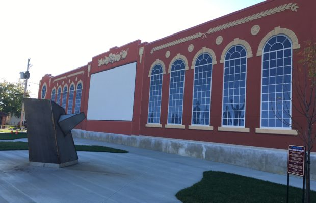 Bucyrus Schines Art Park Mural with the sculpture Idea Taking Flight